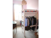 Single wooden bunkbed with desk and clothes rail