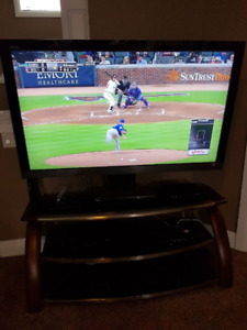 "Sony 55"" LCD TV with sturdy wood and glass stand."