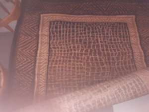 2 5x7 animal print area rugs....$25 each or both for $45