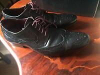 Black leather brogue school shoes