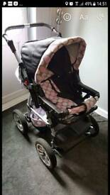 Baby black and pink pushchair stroller