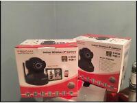2 Foscam Indoor Wireless Cameras. Model FI8918W