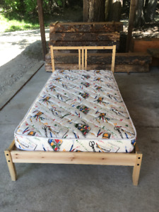 Twin size wooden bed frame and mattress