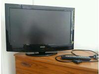 Flat screen TV, integrated DVD player