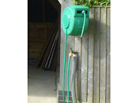 Hoselock wall mounted auto rewind hose & reel