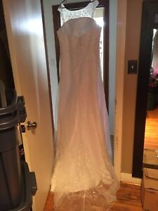 Never worn wedding dress size 22