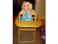 Talking doll and a wooden chair, great condition