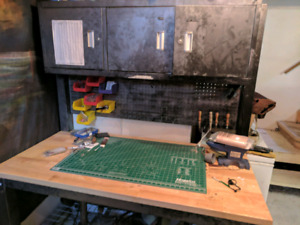 Steel workbench with cabinet storage and pegboard