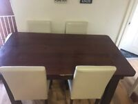 Dining table and six cream chairs