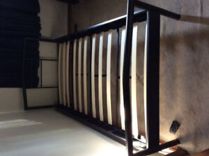 Twin size metal bed frame with slats.