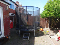 (Barely Used! - Cost £200) Large trampoline with added safety enclosure.