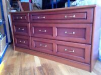 Chest of drawers and two matching bedside cabinets.