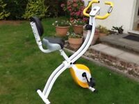 EXERCISE BIKE - Used a couple of times, excellent condition, no marks, folds away