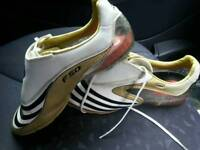 Adidas tunit F50 size 7 in white and gold.