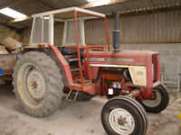 International 674 Tractors for Sale. One with Farmhand Loader.