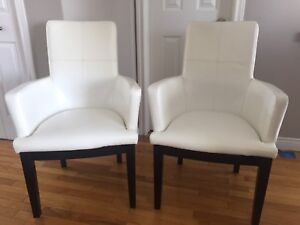 White bonded leather side chairs