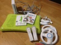 WiFit console, balance board, x2 controllers, extra game.