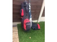 A right handed set of Regal golf clubs with bag and brolley
