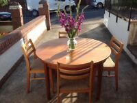 RETRO EXTENDING TABLE AND FOUR MATCHING CHAIRS --can deliver