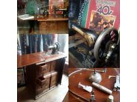 Fully working Singer sewing machine. Hand or treadle operated. Beautiful cabinet (top needs T.L.C)