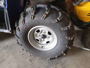 27inch mud lites and 2015 Yamaha grizzly rims