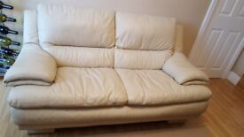 Two seater leather sofa and storage footstool