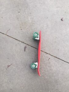 Pink and teal x games penny board.