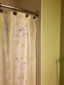 Fabric shower curtain with matching hooks