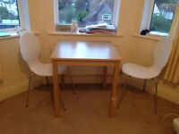Table and 2 chairs, in good condition