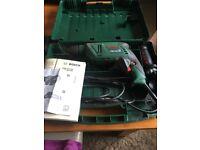Bosch drill and drill bits.