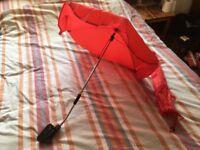 Red pram parasol