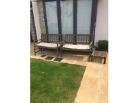 Two garden benches and small side table