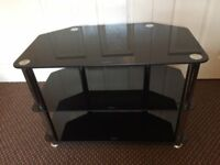 TV STAND BLACK GLASS, SCRATCH LESS CLEAN CONDITION, SIZE Wide 27 Inch, Deep 15 Inch, Hight 19 Inch.