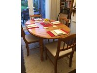 SOLID PINE EXTENDING TABLE AND CHAIRS, AND 2 MATCHING BURGUNDY LEATHER SOFAS