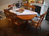 Ornate, wooden, 6-seater table with extender feature & 6 chairs included. In near perfect condition.