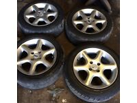 Set of Mazda 323 1999 alloy wheels 4 good road legal tyres 195 55 15 5 stud