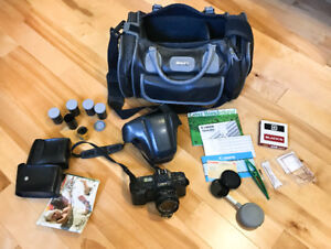 Canon T70 SLR w/ 50mm lens + 5 roll films + LOTS of accessories