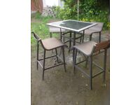 Patio set - Lovely glass top poser table with 4 chairs.