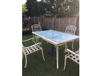 Glass table and 4 chairs good condition