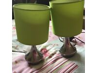"""Two lime green """"touch on"""" bedside lamps"""