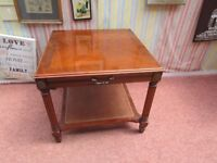 "**REDUCED** LOVELY SOLID WOOD TABLE ON REEDED LEGS & UNDER SHELF WITH A DRAWER 25""SQUARE X 21"" TALL."