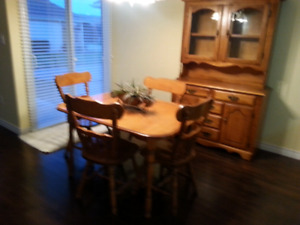 Dining room table and chairs and hutch
