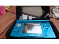 Ninetendo 3ds console in electric blue with games