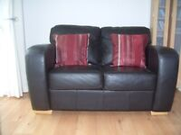 Brown leather 2 seater sofas x 2, never used and a bargain buy!