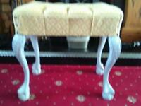 Carved legged stool, with fabric seat.