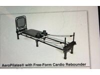 Pilates Machine with rebound board and head/neck support. Unwanted gift.