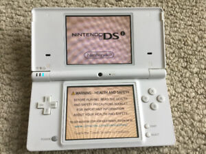 Nintendo DSi with Charger and 60 Games
