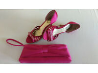 Satin fuchsia heels and small clutch bag. Excellent condition.