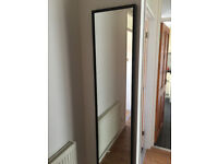 mirror in black wooden frame