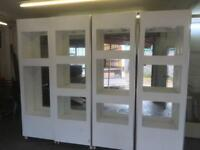 White Mirrored Display Cases.